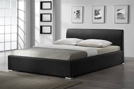 contemporary bedroom with queen leather bed headboard and dark