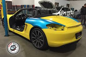 yellow porsche boxster porsche boxster wrapped in 3m satin ocean shimmer blue wrap bullys