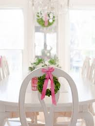 twas the night before christmas canterbury cottage designs decorations in my dining room a nice table centerpiece and preserved boxwood wreaths tied to the back of the dining room chairs with a pink ribbon