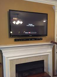 best chic hang tv above fireplace where to put cabl 8573