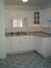 Tile Under Kitchen Cabinets Furniture Traditional Kitchen Design With Cozy Tile Flooring And