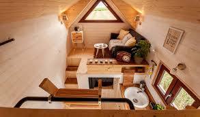 fully furnished odyssée tiny house from france easily fits a