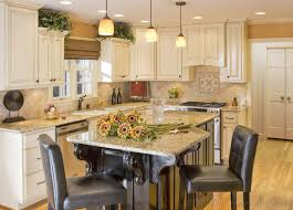 crown molding on cabinets and a darker paint color close to the
