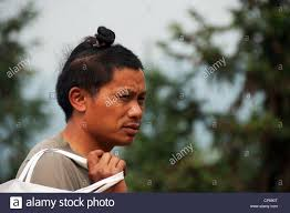 southern man hair style a basha miao gun men adult man with traditional hairstyle
