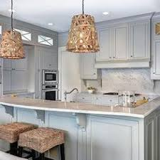 Paint Kitchen Cabinets Gray These Taupe Kitchen Cabinets Are Shown With Perimeter Cabinetry In
