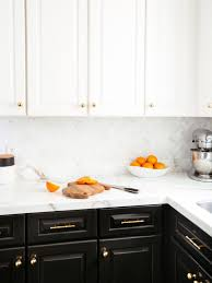 black kitchen cabinets with marble countertops black and white cabinets separated by marble countertop and