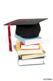 buy graduation cap graduation cap on stack of books buy this stock photo and