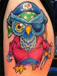 cool cartoon like colored pirate owl tattoo on shoulder tattoos