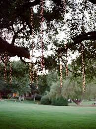 these hanging string lights from trees i when