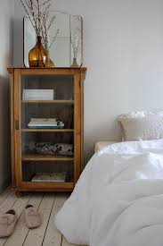 Glass Front Living Room Cabinets Love This Vintage Curio Cabinet In This Bedroom Beautiful Storage
