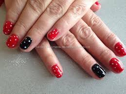 red and black gelux gel polish on natural nails with polka dots