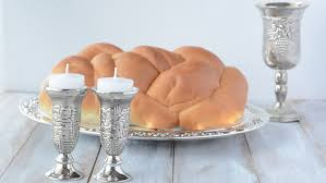 shabbat lights shabbat candles with challah bread and wine stock footage