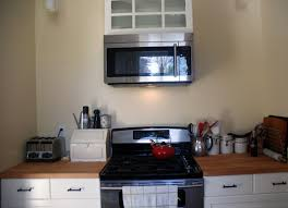 microwave in cabinet shelf over the stove microwave shelf wehanghere