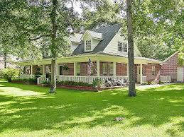 country style houses country style homes wrap around porch texas brick architecture