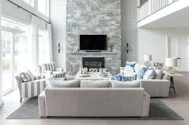 blue and gray living room two story fireplace blue and gray living room with a two story