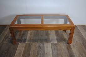 route 66 furniture wooden coffee table with two glass panels