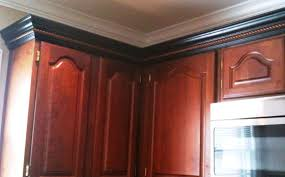 crown moulding ideas for kitchen cabinets cherry cabinets black molding black crown molding kitchens