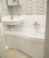 find another beautiful images cute half bath tucked under stairs