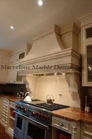 Kitchen Hood Designs Cast Stone Range Hood In 12ft Ceiling Kitchen In Florida 60