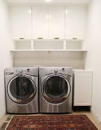 hidden laundry hamper washer dryer cabinet plans best 25 washer dryer shelf ideas on