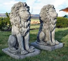 pair of large cast sitting ornaments for the garden