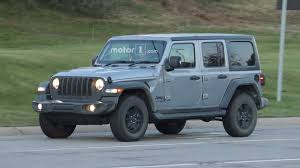 teal jeep entire 2018 jeep wrangler lineup photographed on road 40 images