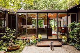 exterior cozy concrete walkway and glass wall plus outdoor potted
