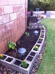 vegetable garden with cinder blocks and wooden fences using