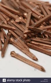 pile of brown copper nails stock photo royalty free image