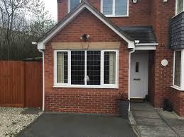exterior enchanting garage conversion with brick wall and paint