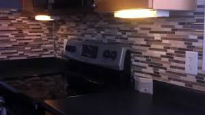 fasade backsplash panels cabinets with wine rack how to cut