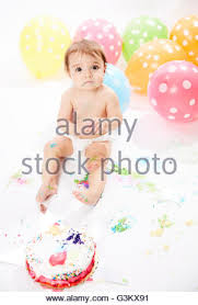 babies with balloons on floor stock photo royalty free image