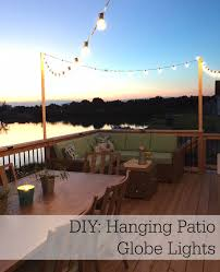 all the pretty things diy how to string globe lights on your patio