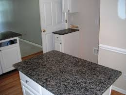 new caledonia granite for a traditional laundry room with a black