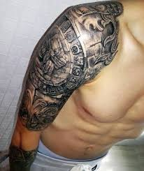 cool old aztec symbol tattoo design on men right upper arm