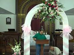 wedding arches in church wedding decorations fresh flowers orchids lillies and roses