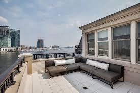 tom clancy u0027s massive baltimore penthouse now seeks 8 7 million