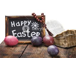 decorative eggs that open decorated with painted easter eggs and an open bible wooden table
