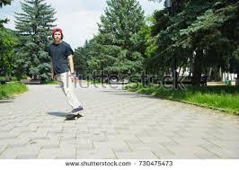 long haired skater boys longhaired hipster skater cap sits on stock photo 663536944