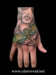 cicada hand tattoo by claire reid tattoonow