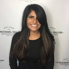 long hair styles with swoop bangs black hair women s long dark layered cut with side swept bangs and balayage