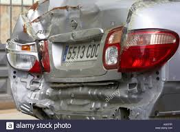 silver nissan car rear end accident crash damage to rear of silver nissan almera car