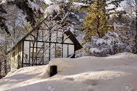 Tudor Style Cottage White Tudor Style Cabin In The Woods In Winter Covered In Snow