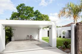 house breeze block simple flat roofed carport covered area