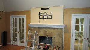 putting a tv over a fireplace tv over fireplace using down and out