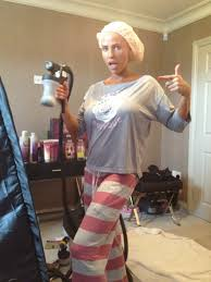 katie price posing with her crazy angel professional spray tanning