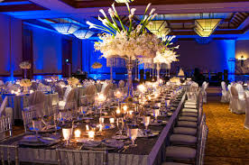 banquet table decorations photos white flowers on the high glass vase plus candles and eating