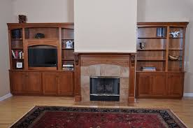 custom fireplace mantel and entertainment center by h u0026m woodworks