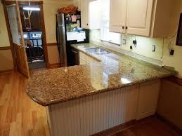 granite countertop french oak kitchen cabinets cinnamon raisin