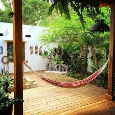 indulge your wanderlust with these dreamy airbnb hammocks brit co